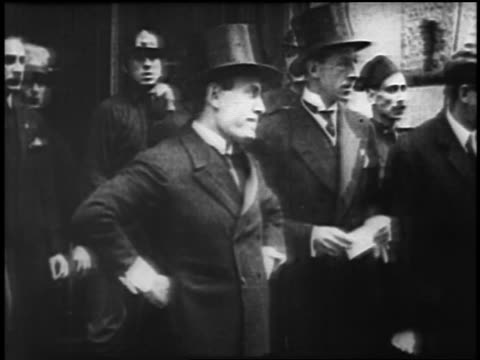 vídeos de stock e filmes b-roll de b/w 1929 young benito mussolini in tuxedo top hat standing with hands on hips / rome / newsreel - benito mussolini