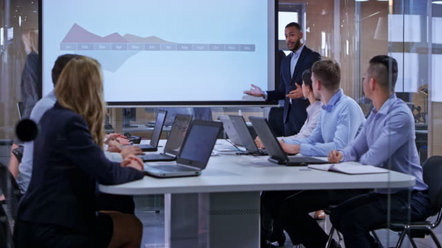 ds young biracial business man holding a presentation in the glass conference room - manager stock videos & royalty-free footage