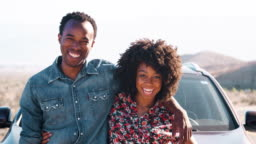Young black couple having a roadside stop off, close up
