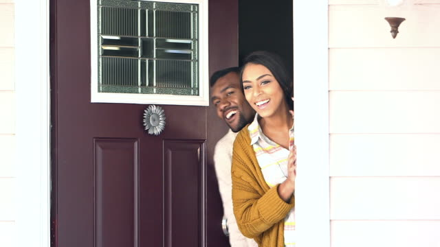 young black couple welcoming visitors to their home - doorway stock videos and b-roll footage