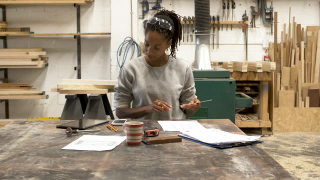 young black female designer working in a woodworking workshop - industrial designer stock videos & royalty-free footage