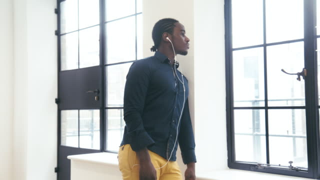 Young Black Male CEO listens to podcast