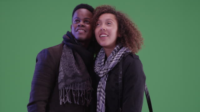 Young black man and woman explore the city on green screen