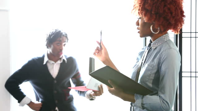 young black man and woman in business meeting - dreadlocks stock videos & royalty-free footage