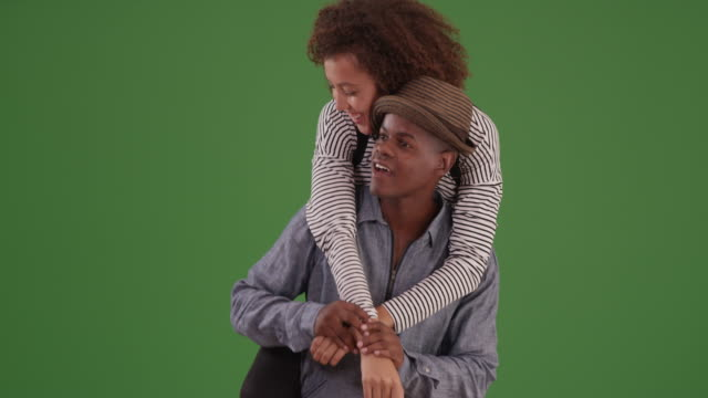 young black man carries his girlfriend on green screen - chroma key studio stock videos & royalty-free footage