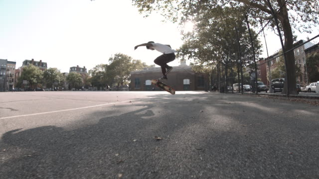 A young, black man skateboards through the streets of Brooklyn in Slow Motion