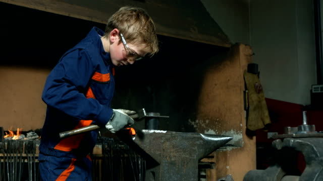 hd dolly: young blacksmith bending wrought iron - metalwork stock videos & royalty-free footage
