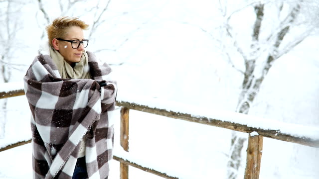 young blond hair woman covering herself with blanket in the winter forest. - blanket stock videos & royalty-free footage