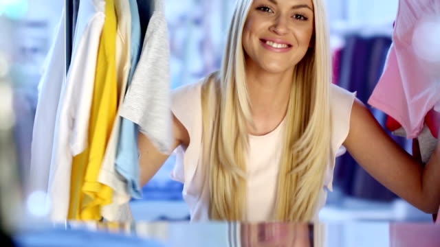 young blond woman with credit cards - five objects stock videos & royalty-free footage