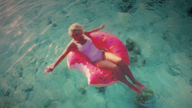 young blonde girl on vacation, maldives - inflatable stock videos & royalty-free footage