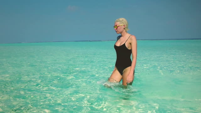 Young blonde girl on vacation, Maldives