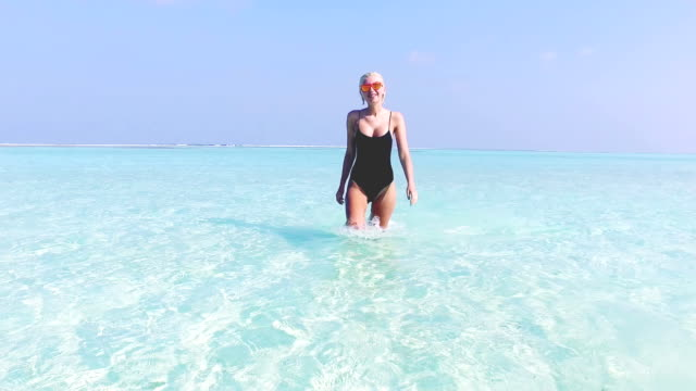 young blonde girl on vacation, maldives - one piece swimsuit stock videos & royalty-free footage