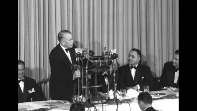 cu young blonde woman at banquet table listens to speech / ms vp alben barkley at cbs and nbc and other microphones at head table ralph bunche is two... - waldorf astoria new york stock videos & royalty-free footage