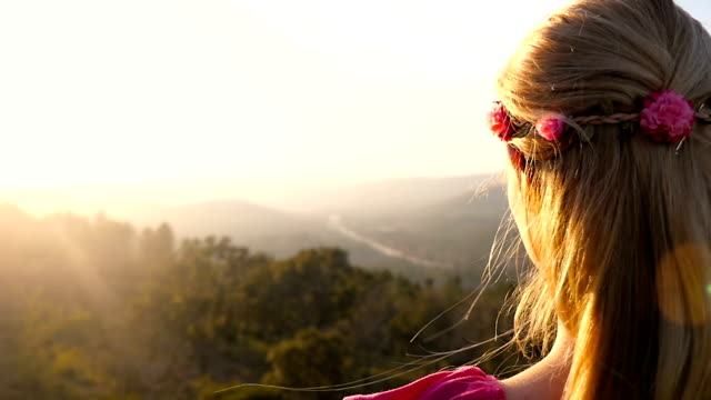 Young boho girl looking at mountains