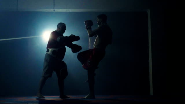 young boxer training with his coach - kickboxing stock videos and b-roll footage