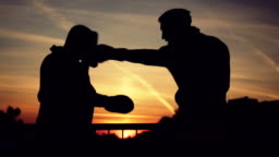 Young boxer training with his coach