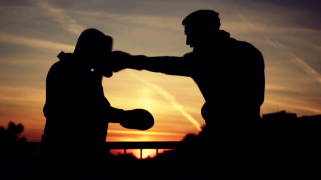 young boxer training with his coach - endurance stock videos & royalty-free footage