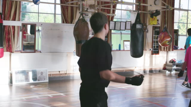 young boxers skipping at a local club - boxing stock videos & royalty-free footage