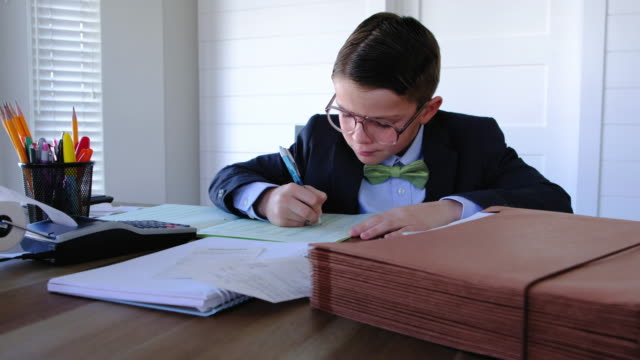 young boy accountant at work - nerd stock videos & royalty-free footage