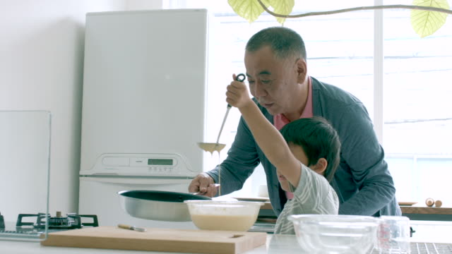 young boy and his grandfather cooking together - only japanese stock videos & royalty-free footage