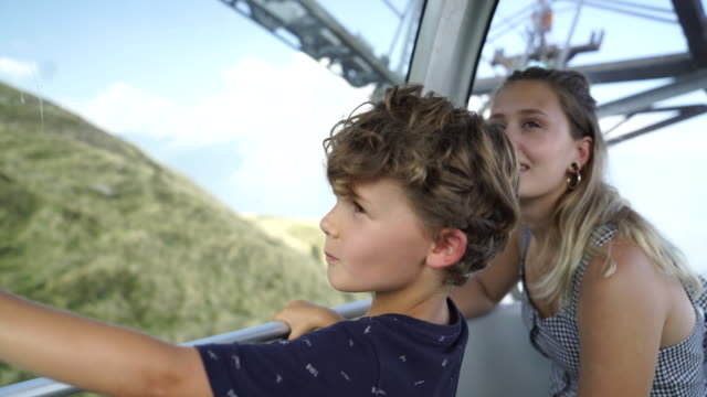 young boy and mother looking out of window on cable car - overhead cable car stock videos & royalty-free footage