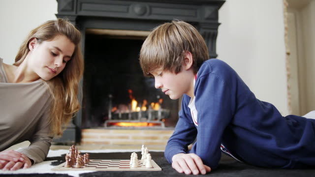 ms pan young boy and young girl playing chess / albi, midi-pyrennees, france - board game stock videos & royalty-free footage