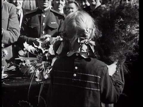 young boy awarded with medal and bouquets of flowers for bravery during battle of stalingrad/ russia/ audio - solo bambini maschi video stock e b–roll