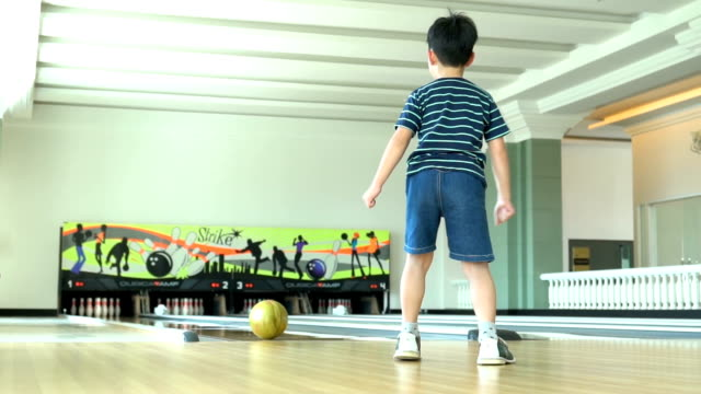 young boy bowling - bowling ball stock videos & royalty-free footage