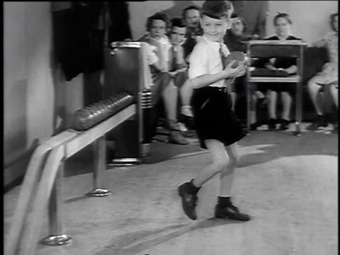 1944 montage young boy bowling / wallingford, connecticut, united states - 1944 stock videos and b-roll footage
