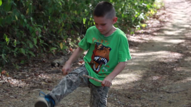 young boy breaks medium size stick on his leg twice then the third time no luck - kelly mason videos stock videos & royalty-free footage