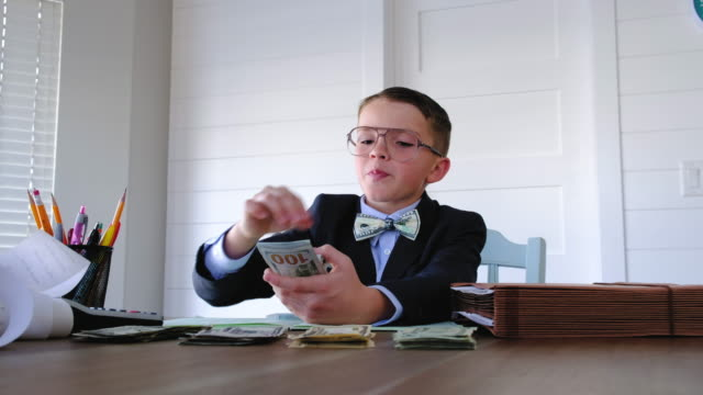 young boy businessman counting money - counting stock videos & royalty-free footage