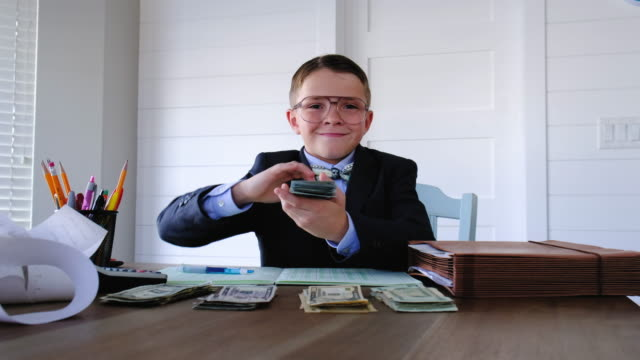 young boy businessman flinging benjamins - throwing stock videos & royalty-free footage