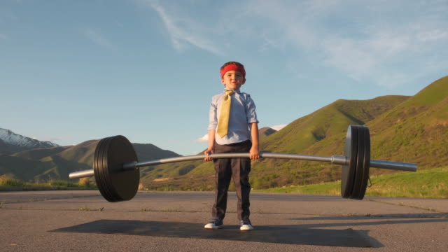 young boy businessman lifting weights - struggle stock videos & royalty-free footage
