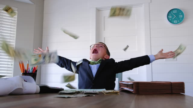 young boy businessman throwing money - lanciare video stock e b–roll