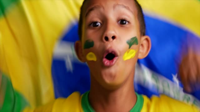 young boy celebrating with brazilian flag - body paint stock videos & royalty-free footage