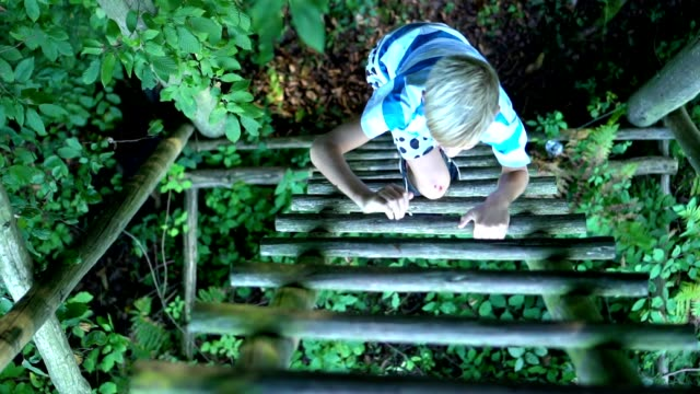 a young boy climbs the ladder - ladder stock videos & royalty-free footage