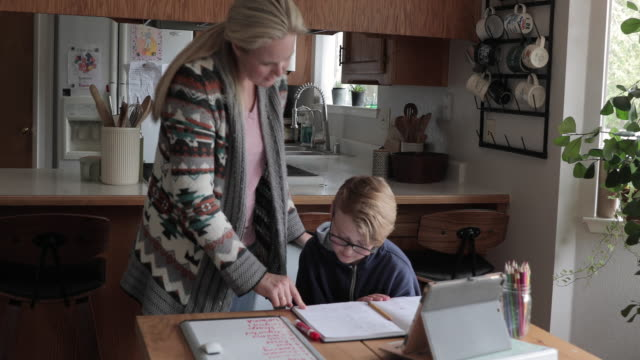 young boy does schoolwork at home - cardigan sweater stock videos & royalty-free footage