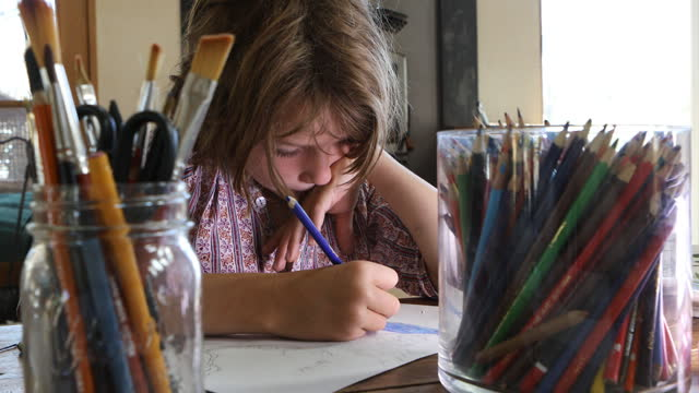 young boy drawing with colored pencils - school supplies stock videos & royalty-free footage