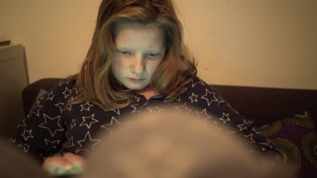 vídeos y material grabado en eventos de stock de a young boy engaged with his computer tablet. - juego electrónico de bolsillo