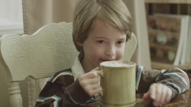Young boy enjoys hot cocoa