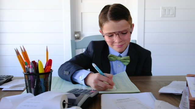 young boy entrepreneur at work - ledger book stock videos & royalty-free footage