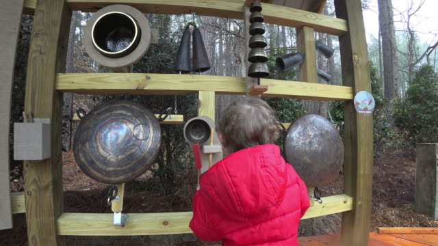 Young boy experimenting with instruments in a soundscape