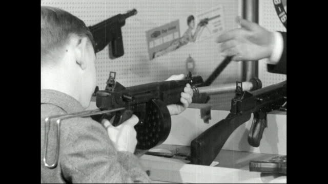 young boy 'fires' toy machine gun; 1959 - 1959 stock videos & royalty-free footage
