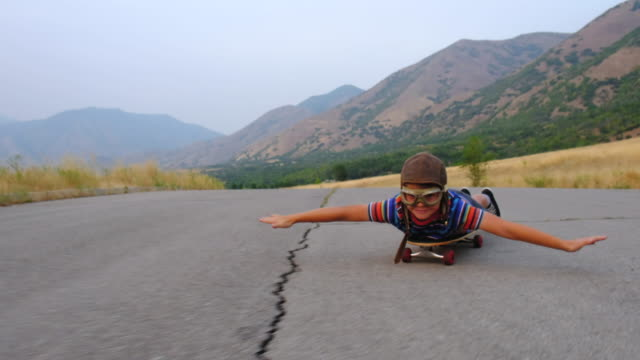 young boy flying on a skateboard - flying goggles stock videos and b-roll footage