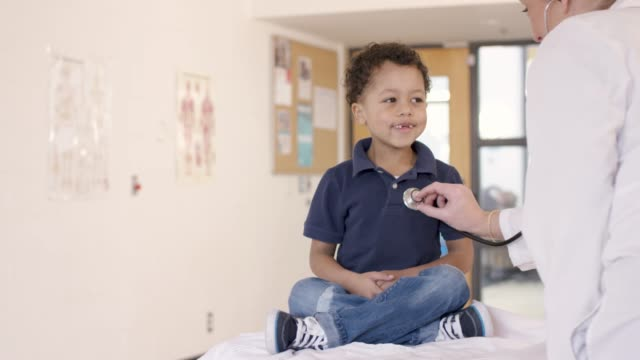 young boy getting  a medical check-up - pediatrician stock videos & royalty-free footage