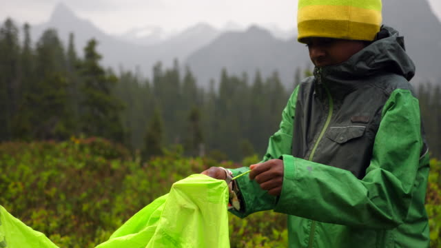 ms young boy helping set up tent during backpacking trip - childhood stock videos & royalty-free footage