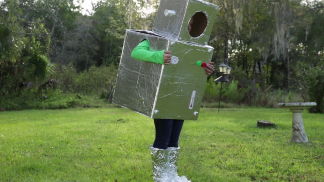 stockvideo's en b-roll-footage met ms ts young boy helps girl to put on home made robot costume - mouw