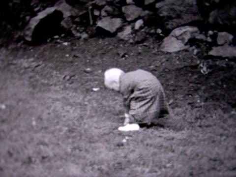 stockvideo's en b-roll-footage met 1935 young boy in big coat - 1930