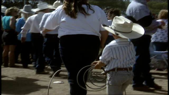 young boy in cowboy hat twirling a lasso over his head - cowboy hat stock videos & royalty-free footage