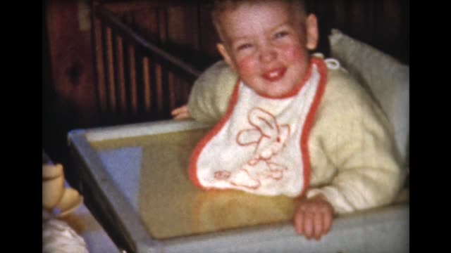 vidéos et rushes de 1959 young boy in high chair laughing - 1950 1959